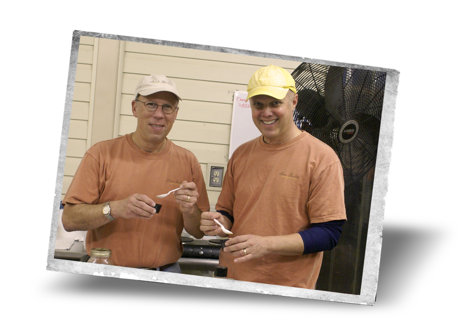 Dr. David Heilbronner and Dr. Bruce Wilhelmsen tasting sauce during product development